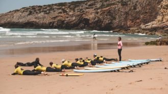 surfers-on-beach